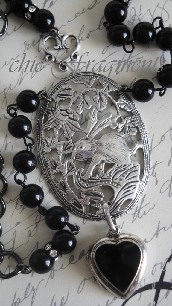 MIDNIGHT Black Onyx Heart Locket Necklace. Rabbit in Sterling Silver. Black Pearls. Antique Assemblage. $115.00, via Etsy.