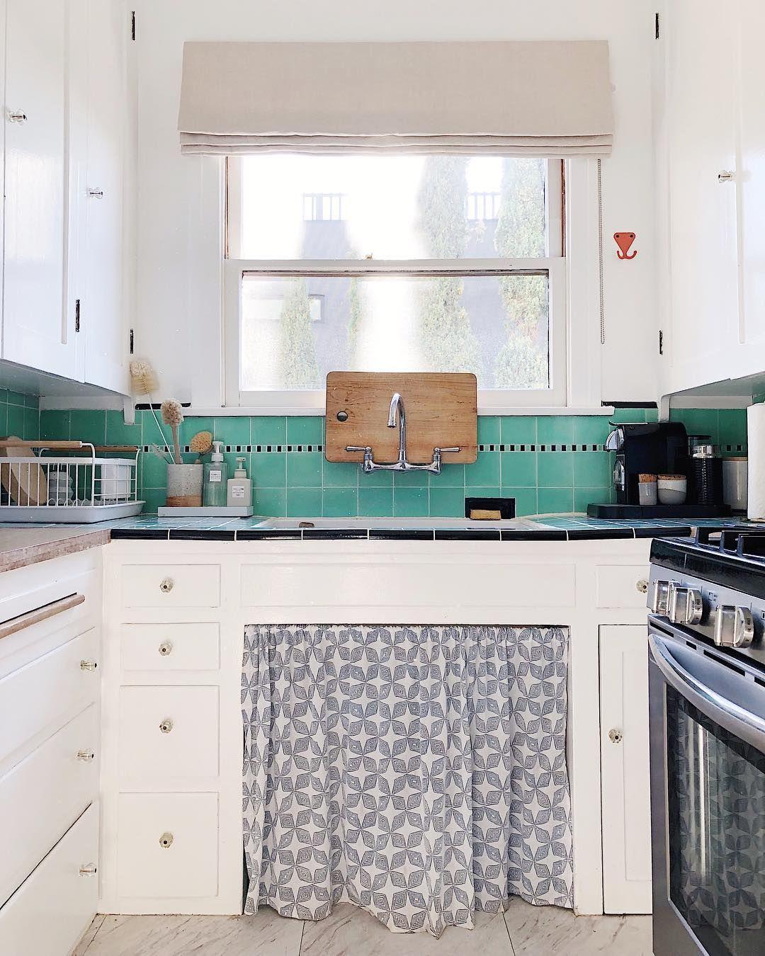 Vintage White Kitchen With Turquoise Backsplash Tile And Cute Sink Skirt Kitchen Inspiration Design Diy Kitchen Renovation Custom Window Coverings