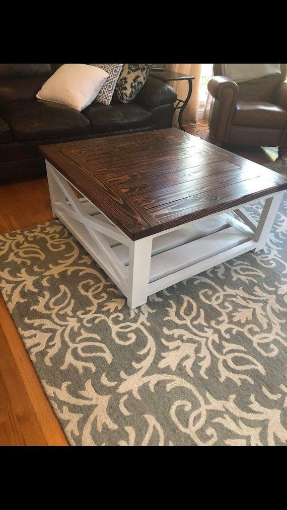 Square Farmhouse coffee table with bread board ends. Table