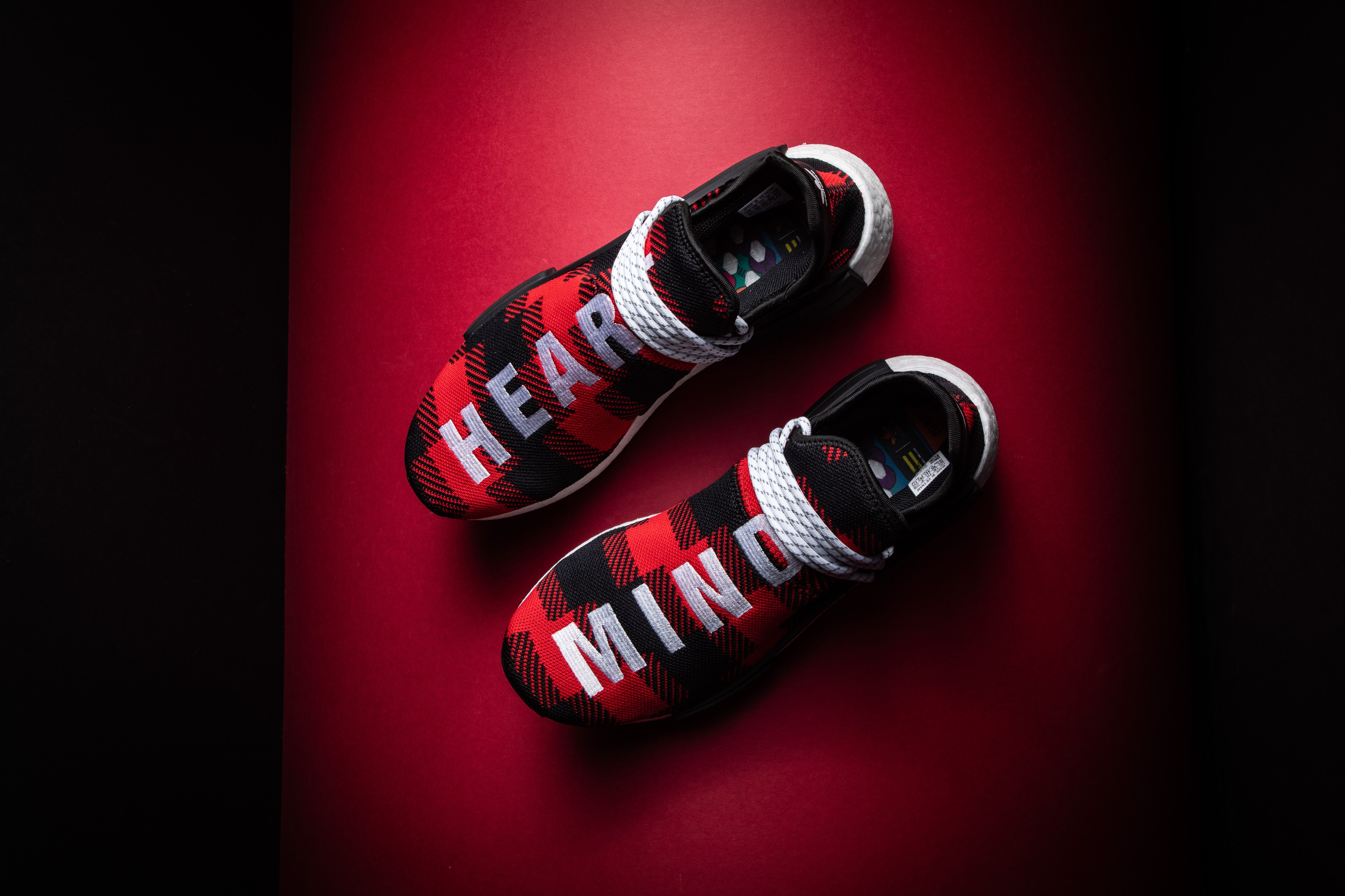 0df8824b In addition to the green and blue plaid colorways of the BBC-exclusive  Pharrell x adidas NMD Hu, the release was also created in this rare red  alternate ...