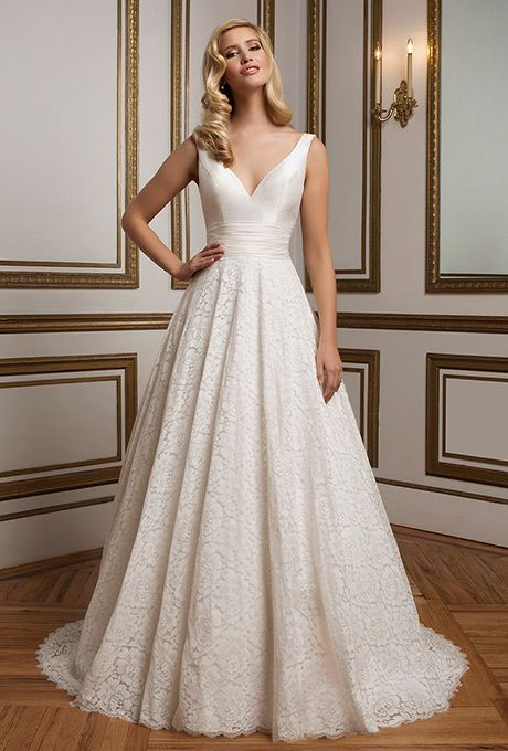 Justin Alexander. Silk dupion V-neckline ball gown with a fitted bodice, pleated cummerbund and finished hem lace that create an ambiance of 1950's glamour.