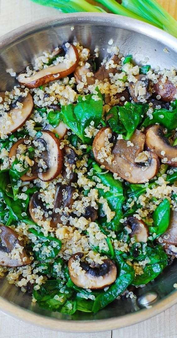 Spinach and mushroom quinoa sauteed in garlic and olive oil. Gluten free, vegetarian, vegan, low in