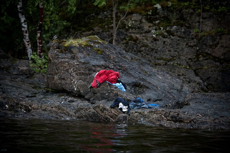 Niclas Hammerström, Sweden, for Aftonbladet, Utøya, Norway, 22 July  Trying to avoid the killer's bullets, many people jumped into the cold water. Anders Behring Breivik killed 69 people on 22 July on the small island of Utøya outside Oslo in Norway. Tragic picture.