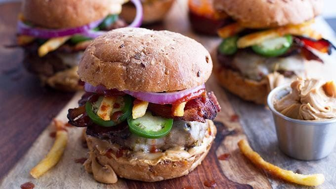 The ultimate sliders are made with peanut butter, sriracha and bacon!