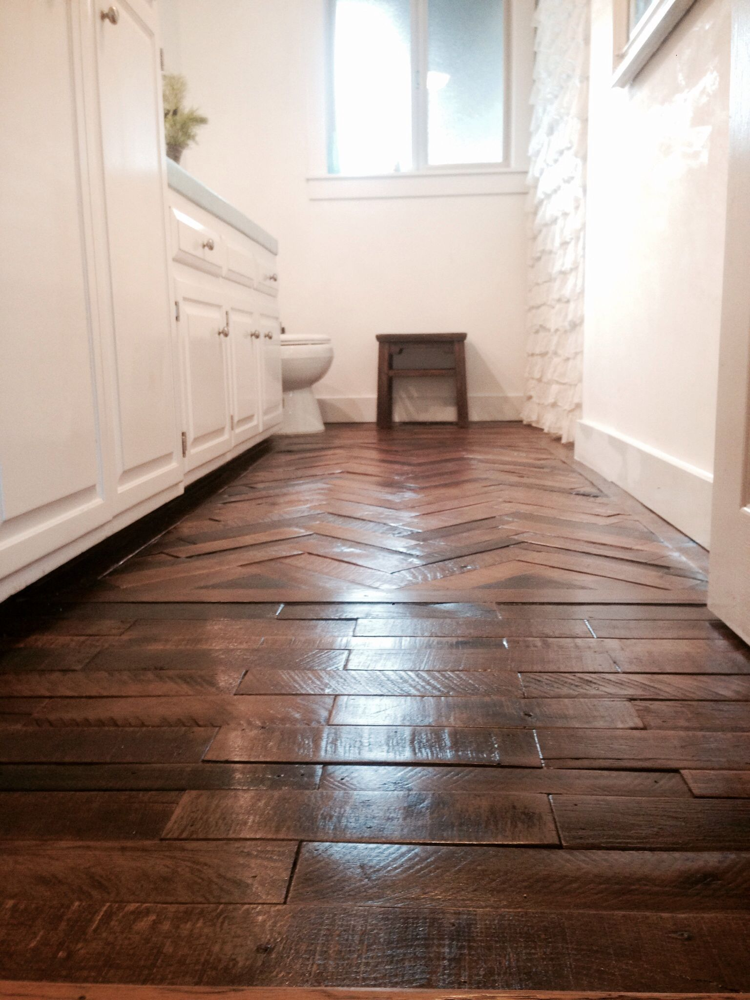 Wood floor made from reclaimed shipping pallets.