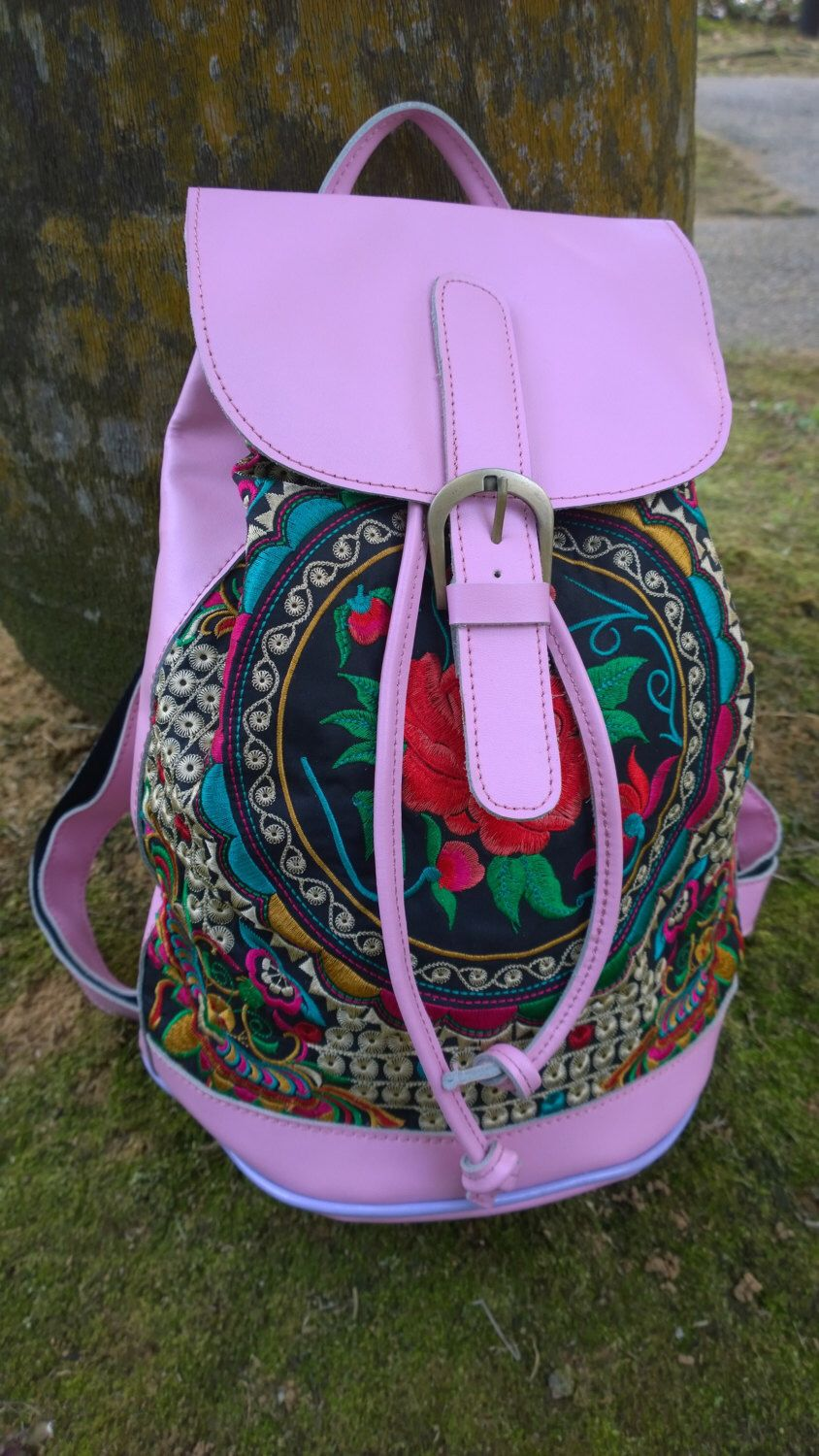 A personal favorite from my Etsy shop https://www.etsy.com/sg-en/listing/254391421/on-sale-pink-leather-embroidery-bag