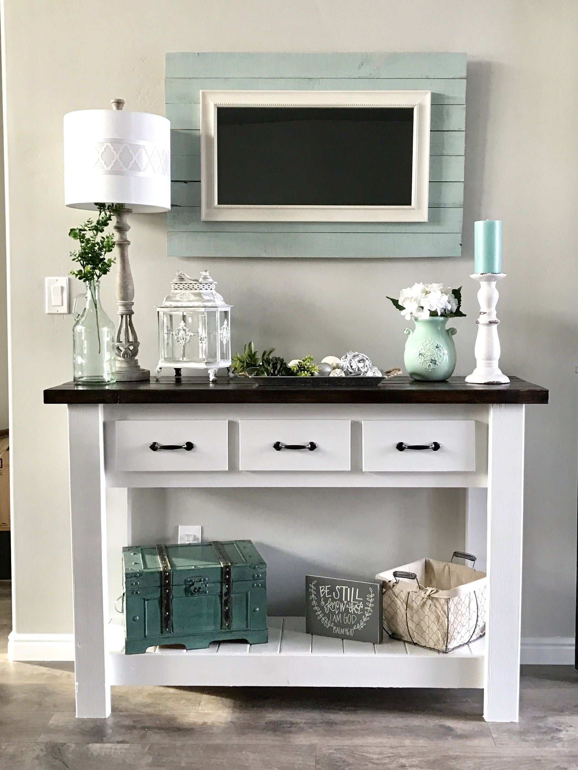 White entry table with decor from hobby lobby