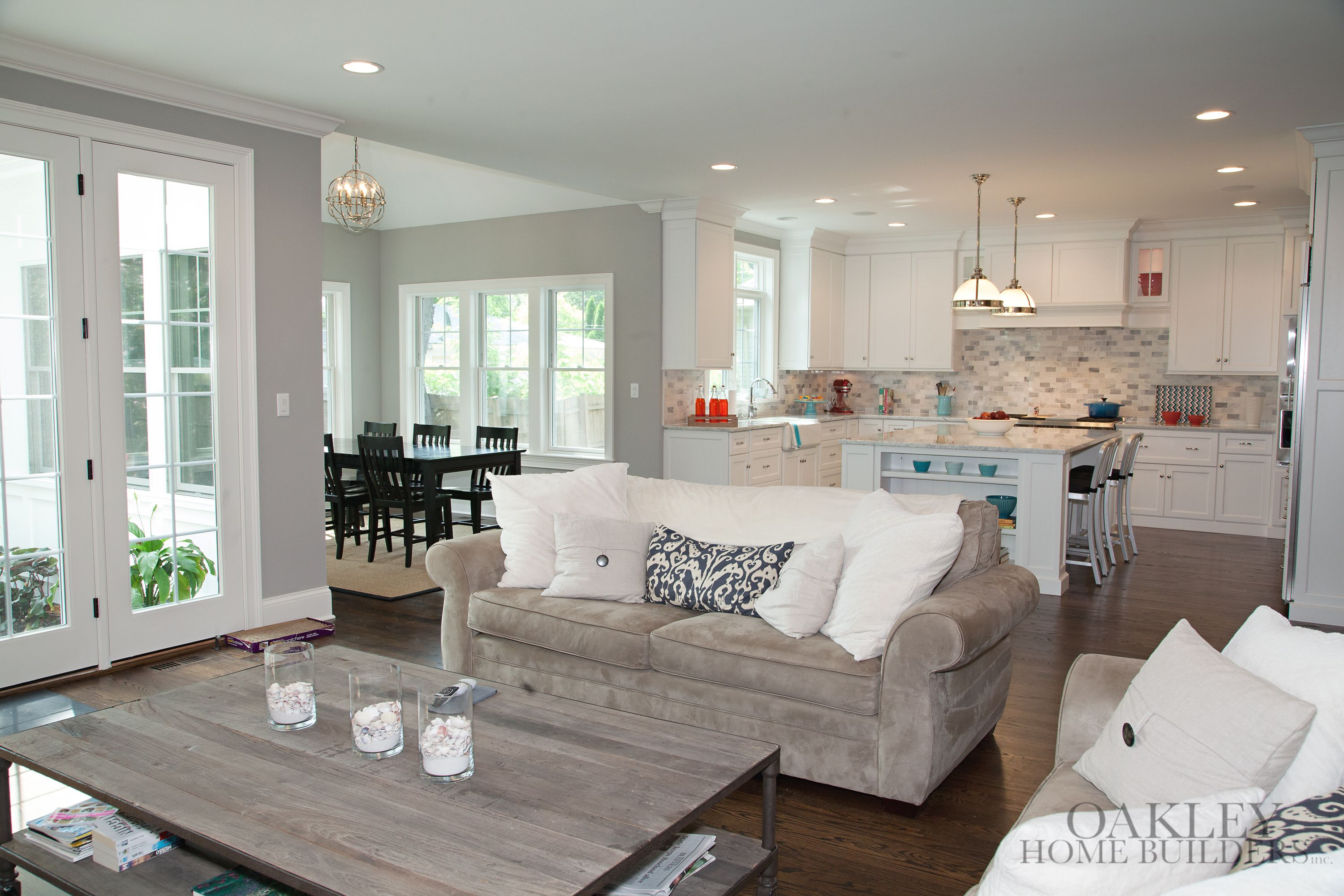 White Kitchen Open Living Room open floor plan, white kitchen, lots of windows | oakley home