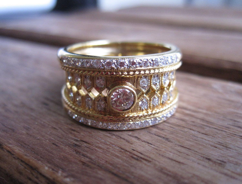 Vintage Estate 18K Solid Gold Bezel And Pave' Diamond Cigar Ring. $1,625.00, via Etsy.