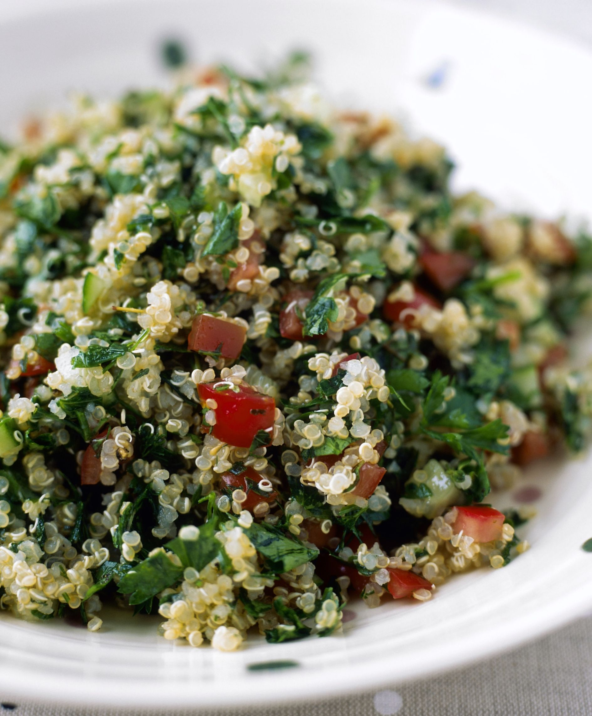 A vegetarian tabbouleh (also spelled tabouleh or tabouli) salad, made with healthy, whole grain and high-protein quinoa. It's really a two-in-one: you get a quinoa salad as well as a traditional Middle Eastern tabbouleh, and it's vegetarian, vegan, and gluten-free.