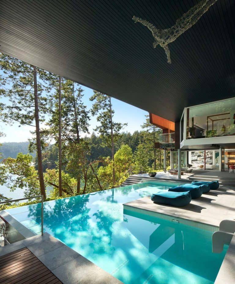 Prefabricated House Of Rusted Steel On The Gulf Islands Indoor Swimming Pool Design Luxury Swimming Pools Luxury Pools