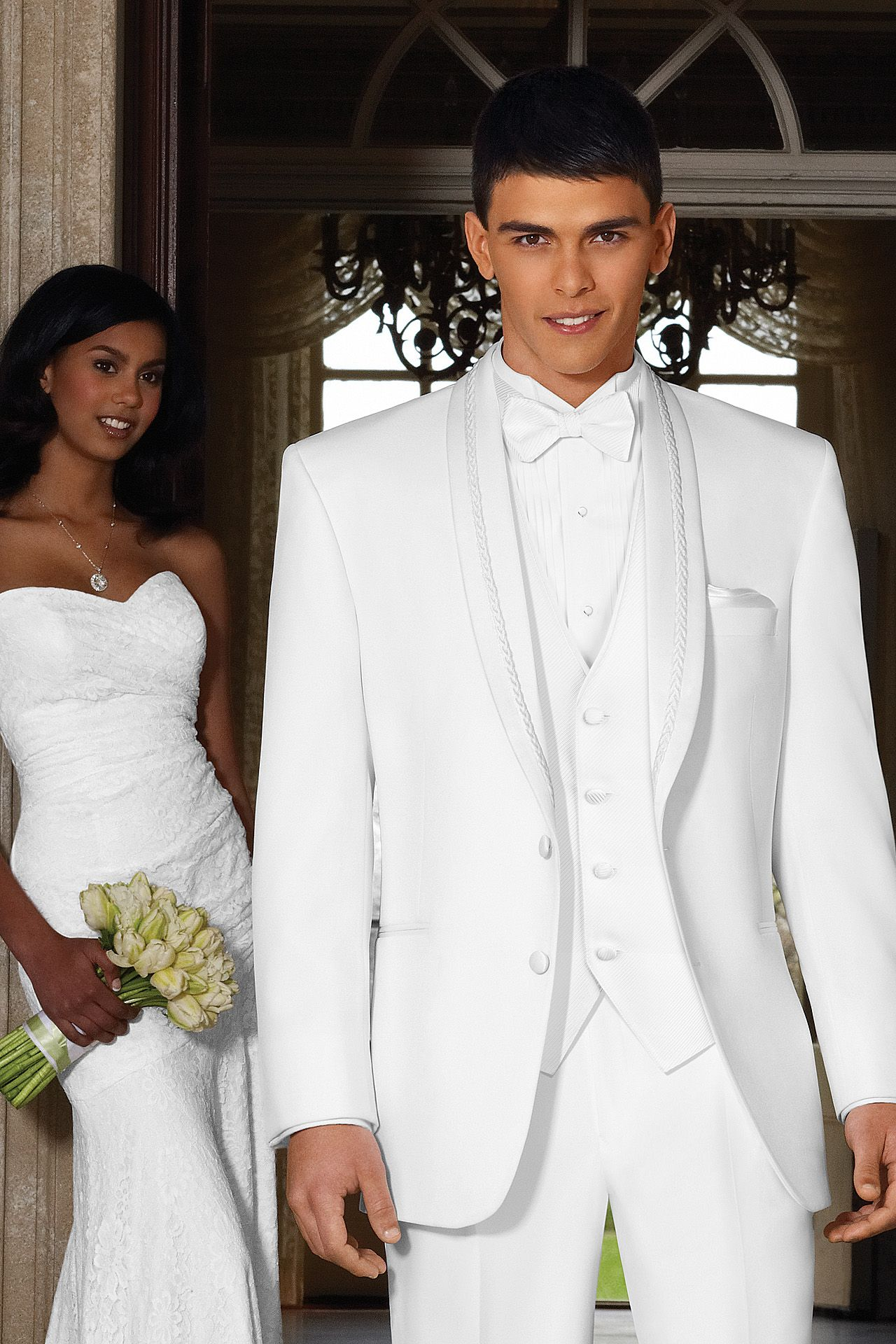 I like the groom in all white too. Jim's Formal Wear