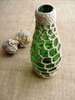 crochet bottle sleeve would make a great little vase & it's a cool way to recycle colored bottles.