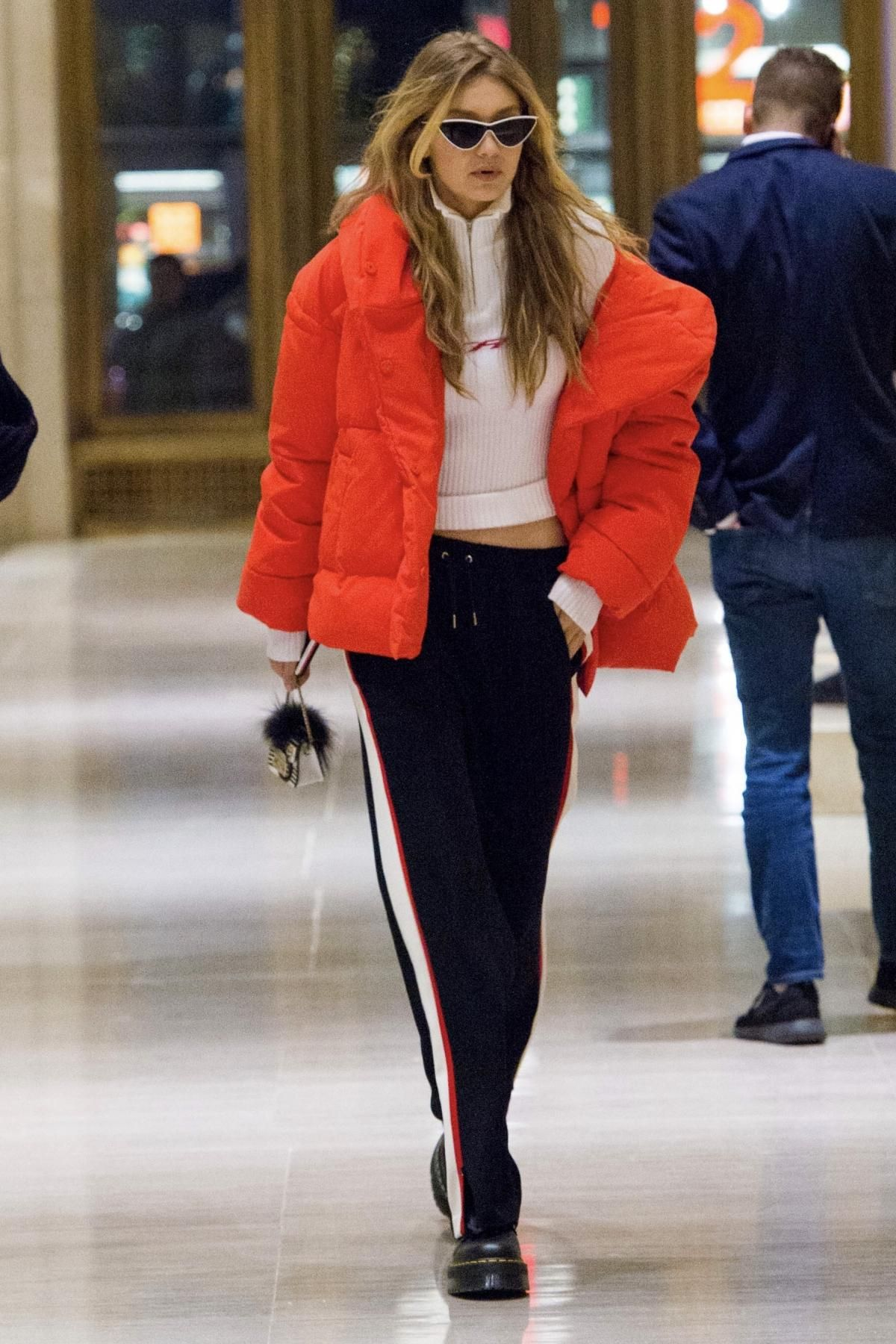 c817a3691f52 Gigi Hadid wearing Dr. Martens Lazy Oaf Jungle Boots, H&M Padded Jacket in  Bright Red, Le Specs X Adam Selman the Fugitive Sunglasses in White, Furla  ...