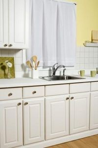 How To Get Rid Of Smells In The Sink Clean Kitchen Cabinets New Kitchen Cabinets Wood Cabinet Doors