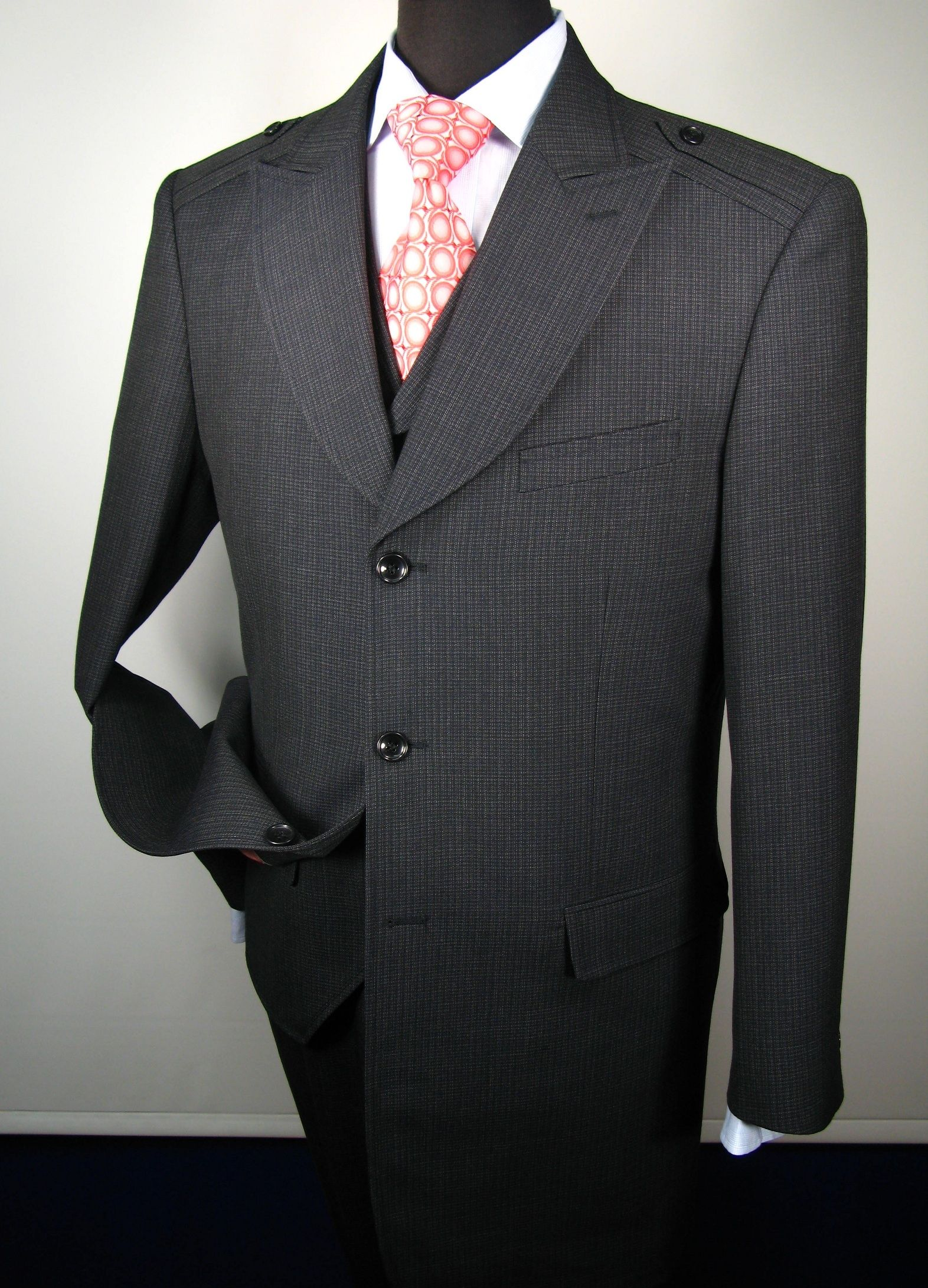 d8d89aef This Solo 360 mens 3 piece suit comes in fashion length. The single  breasted 3 button, 34 inch jacket includes peak lapel, shoulder patch,  besom pocket, ...