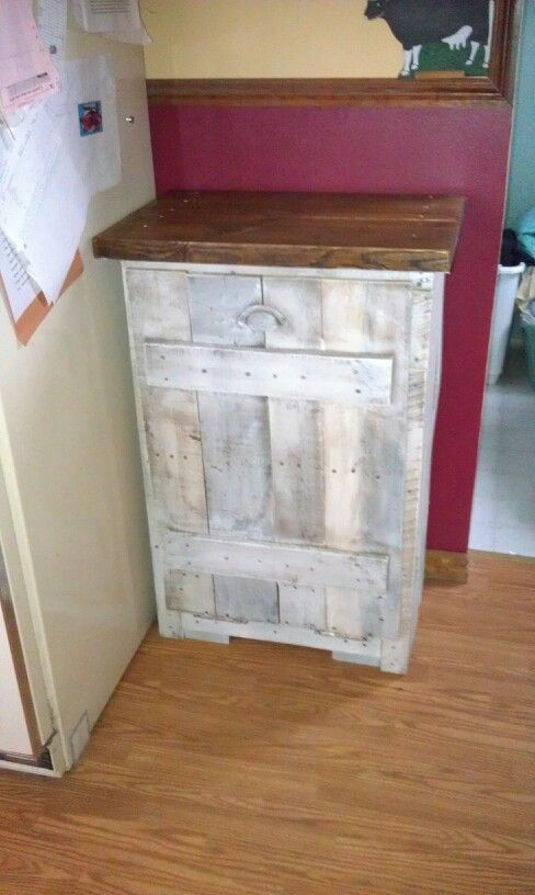 Pallet board used to make a trash can cabinet. | Kathi Kountry ... on paper storage ideas, kitchen garbage furniture, rice storage ideas, kitchen garbage cabinets, kitchen island with built in recycling,
