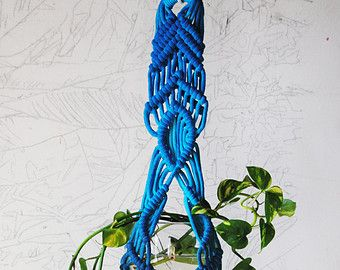 Handmade and dyed Macrame Plant Hanger. Oak dowel 13 1/2 wide, planter approx. 46 long, holds a 5 round pot or vase.  Vase not included  * Please note this will take up to two weeks to ship, as it needs to be made. Also these are handmade, so each one will have a slight variance from the next. THANK YOU