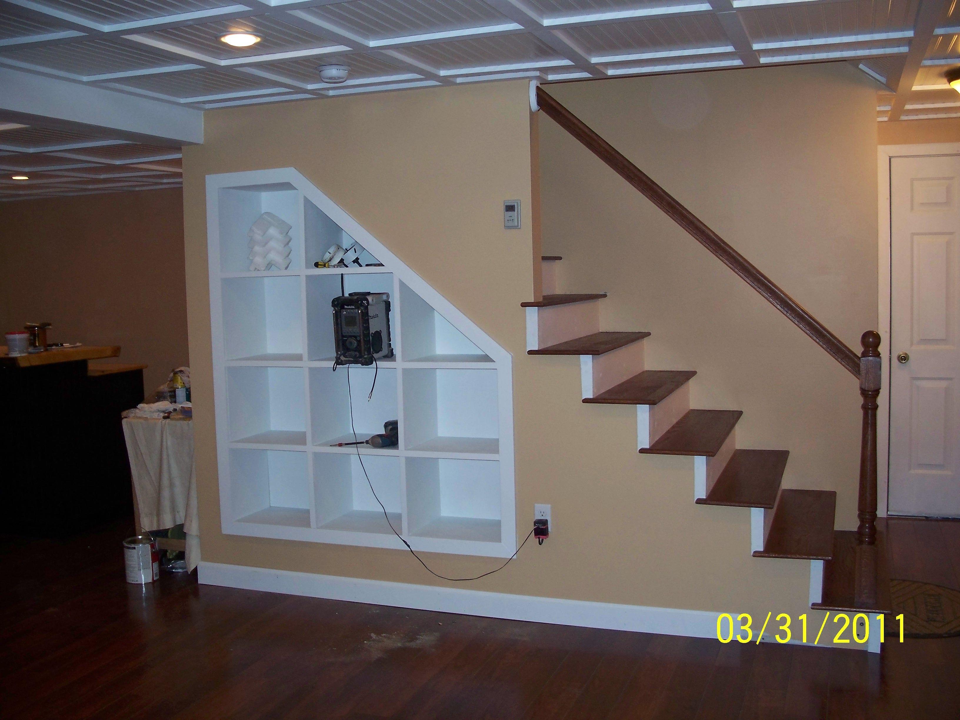 Custom shelving for under stairs. Condo living, Custom