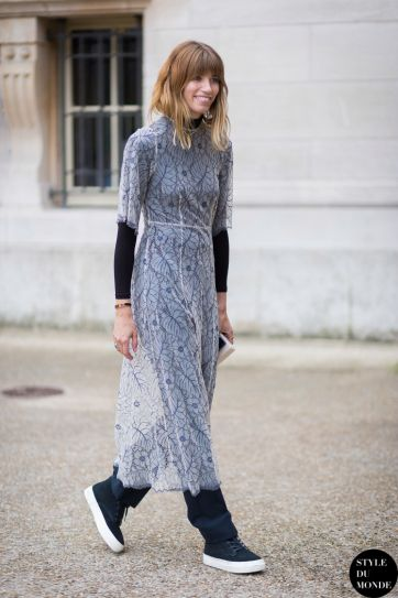 7167511913e4 Winter Outfit Idea - long sleeve black shirt worn under a sheer white lace  midi dress paired with trousers +  cool girl  sneakers