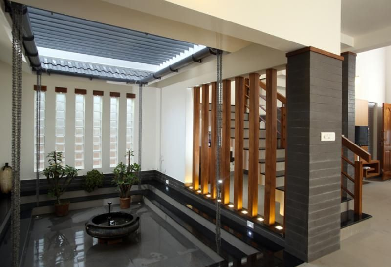 the beams around the courtyard was highlighted with claddingthe beams around the courtyard was highlighted with cladding contemporary courtyard design , kerala homes