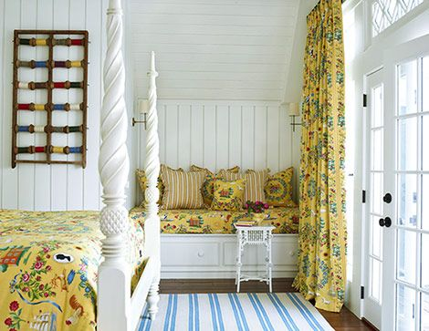 What a sunny and inviting guest room! The cozy daybed under the eaves converts to a baby crib when needed. Fabrics from Lee Jofa and Schumacher