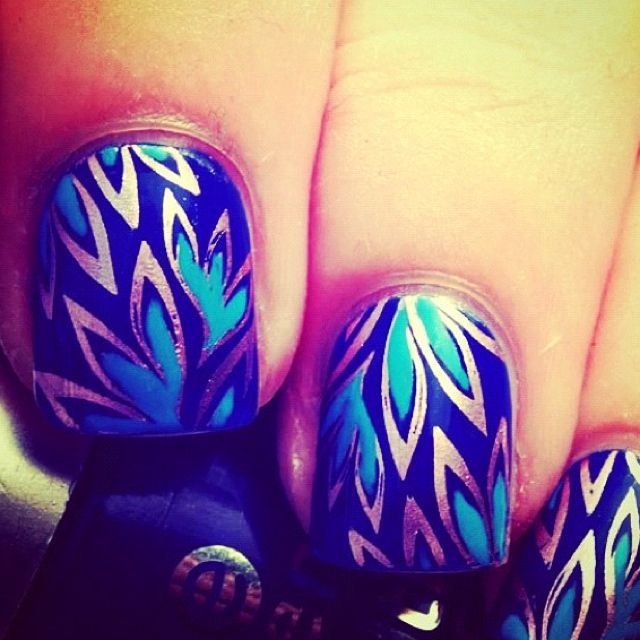 Black, gold and teal fern nails