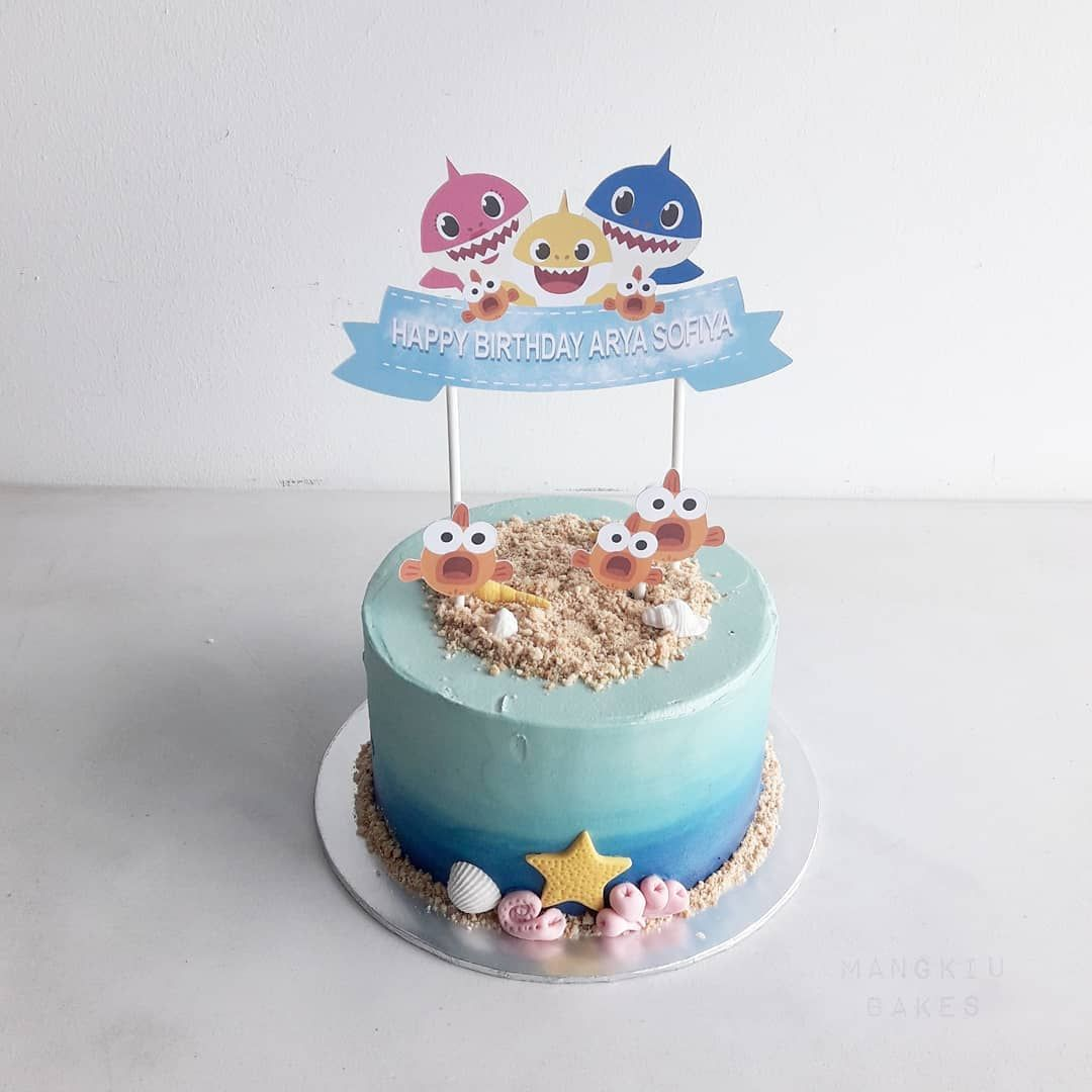 A Simple Baby Shark Cake With Added Paper Topper From
