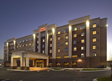 Hampton Inn & Suites|new construction    A design / build method was used to deliver this 146-room new hotel project, which was designed and constructed simultaneously with a Cambria Suites Hotel, both located on the same site.     During design, Stahl suggested that pre-cast concrete be used rather than post-tension methods. By using pre-cast, construction was able to continue through the winter months, saving the owner time and money.