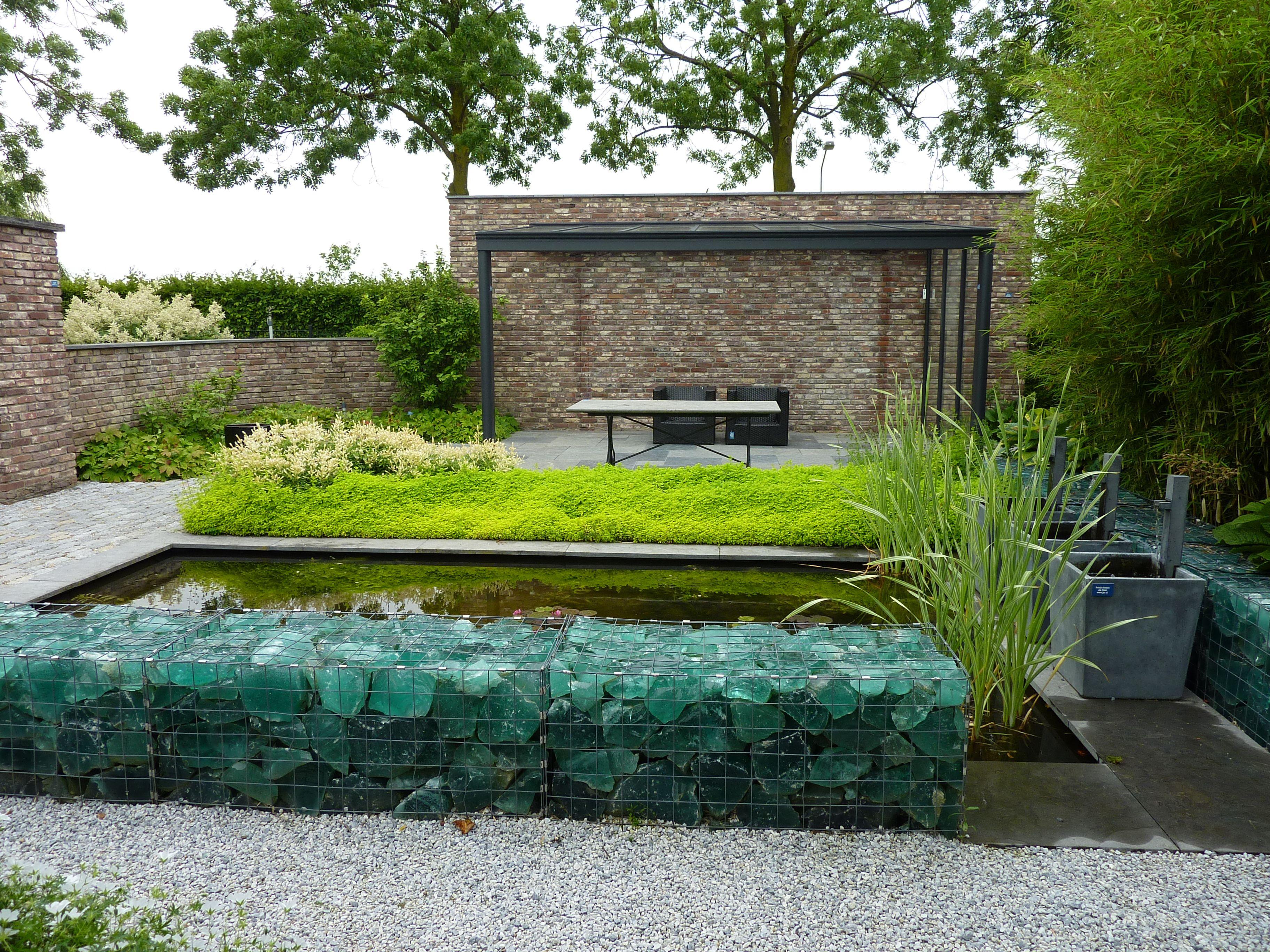 Wasser im garten ziegelmauer gräser gartenreise holland appeltern