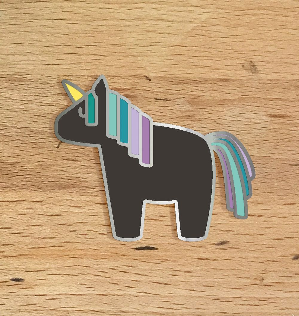 Woohoo! Winning by a landslide, the Midnight Unicorn was voted in to be By  Yivvie's first animal pin. Featuring an enamel charcoal gray body with a  teal & purple mane and tail, outlined in a nickel finish, this chubby  little unicorn will be a perfect addition to your collection! Coat, jack