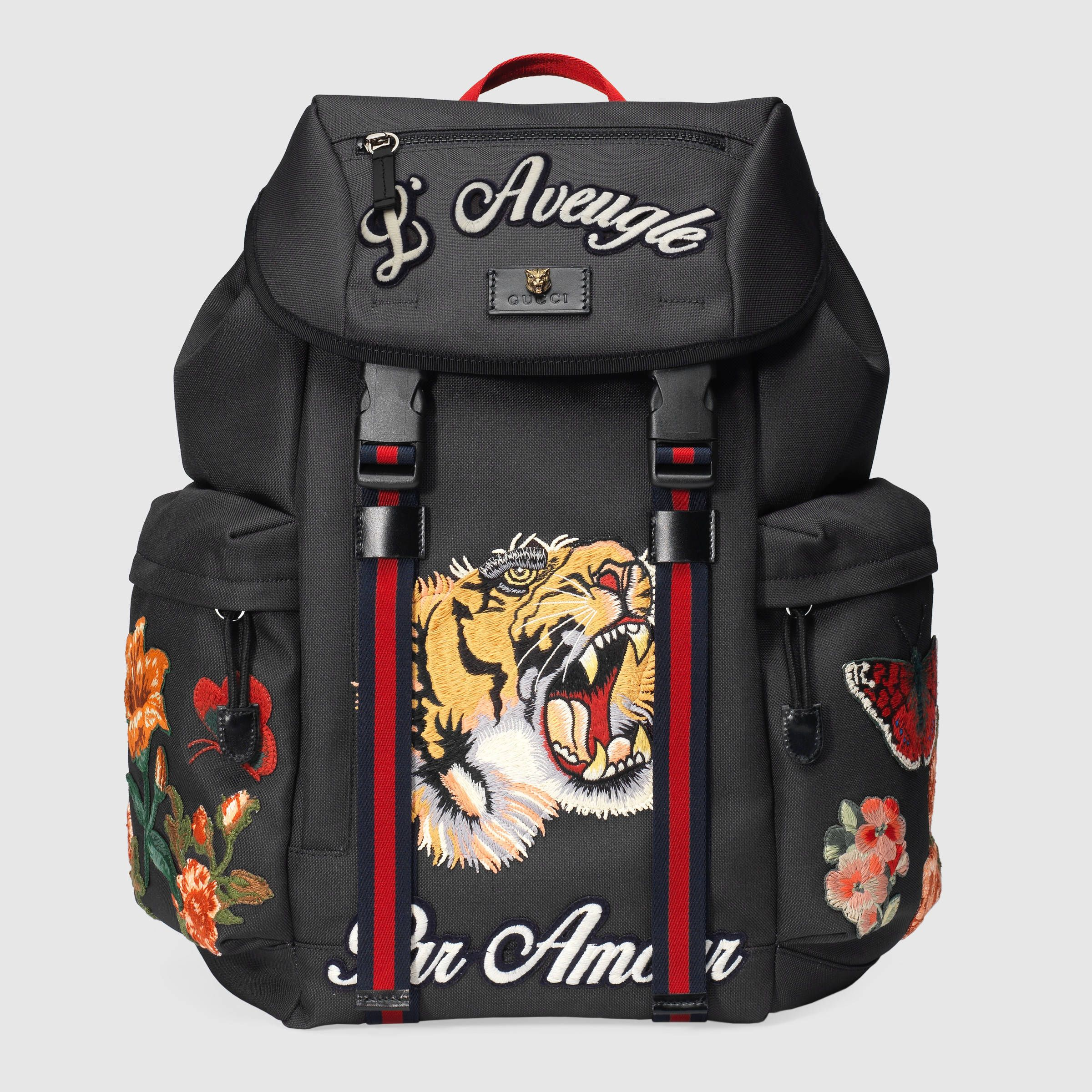 a08b55275 Discover more gifts from the Gucci Garden. The GG Supreme limited edition  backpack, featuring an embroidered kingsnake, heart and flowers.