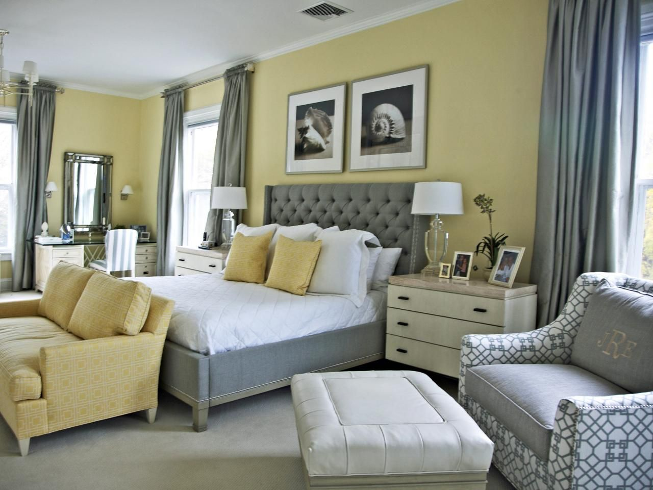 A Sophisticated Traditional Master Bedroom Features A Trendy Gray And Yellow Color Palette Grey Bedroom Design
