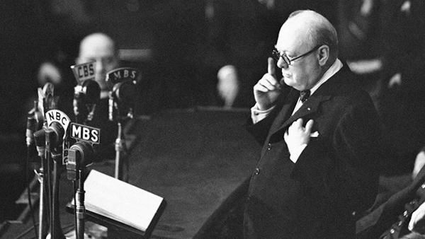 """DECEMBER 26, 1941: Winston Churchill becomes the first British prime minister to address a joint session of Congress.  Speaking just weeks after America's entry into WWII, Churchill warned of a long and hard struggle against the Axis powers, and vowed that Britain and America would fight together, """"side by side in majesty, in justice, and in peace."""""""