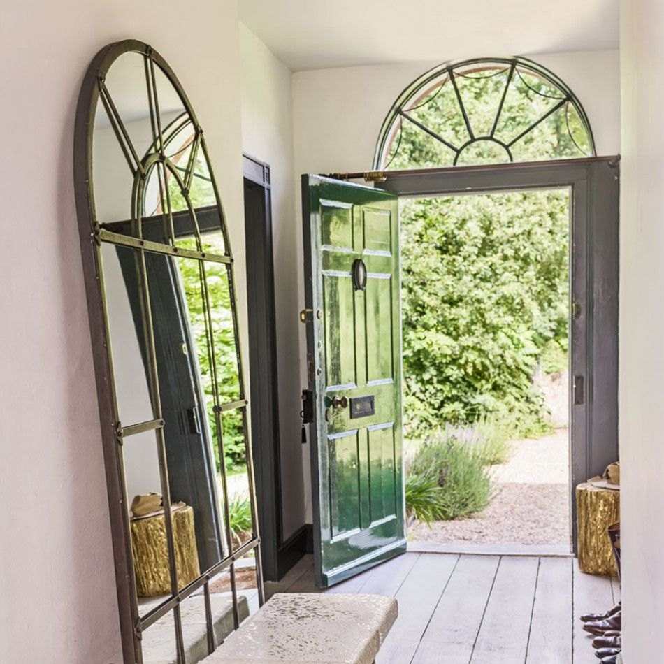 leaning large with size base arched living twice make brass to mirror your room the wall against feel floors gallery floor photos molding mirrors