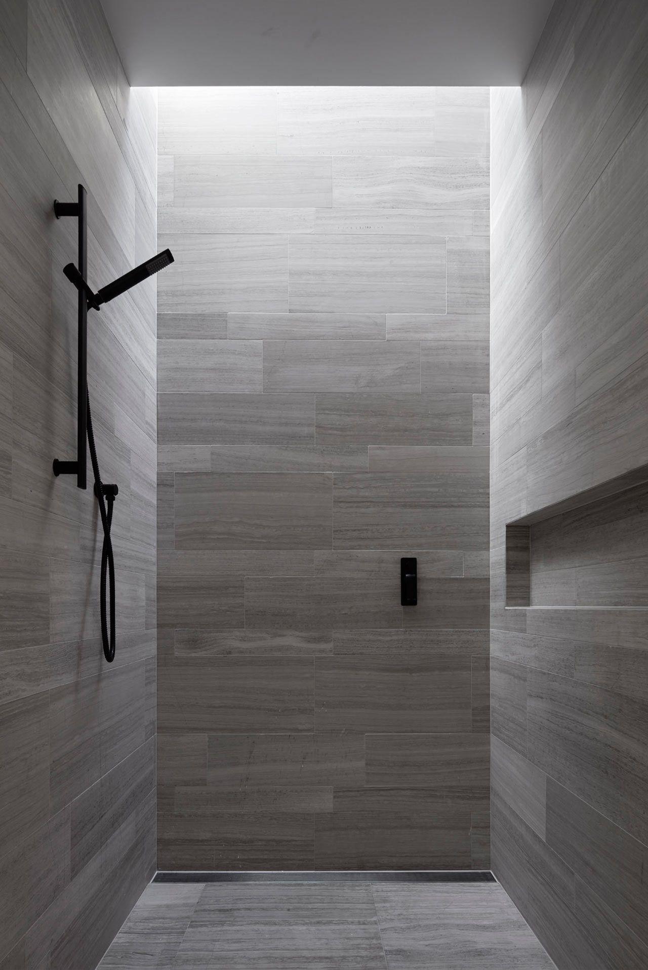 A Residence Clad In Rough Lava Stone Modern Bathroom Design
