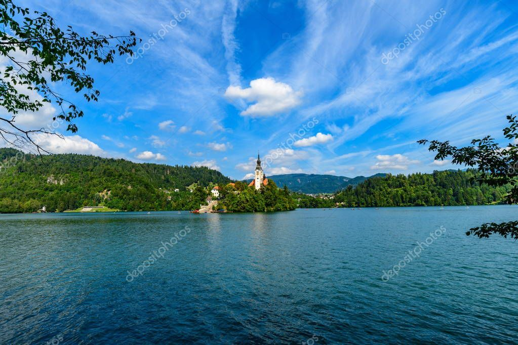 A Beautiful Landscape Of A Mountain Lake Bled With The Island And The Famous Chu Ad Mountain Lake Beautif Beautiful Landscapes Lake Bled Mountain Lake