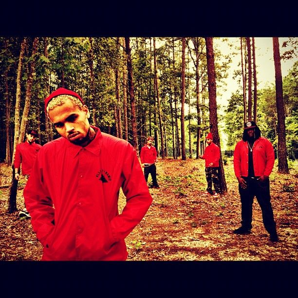 Chris Brown rockin' the Red windbreaker.