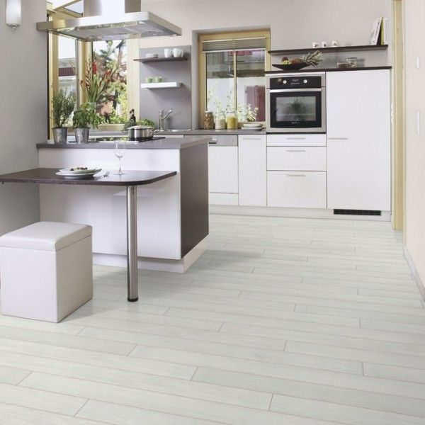 Interior washed laminate wood floor in white color for for White kitchen cabinets with hardwood floors
