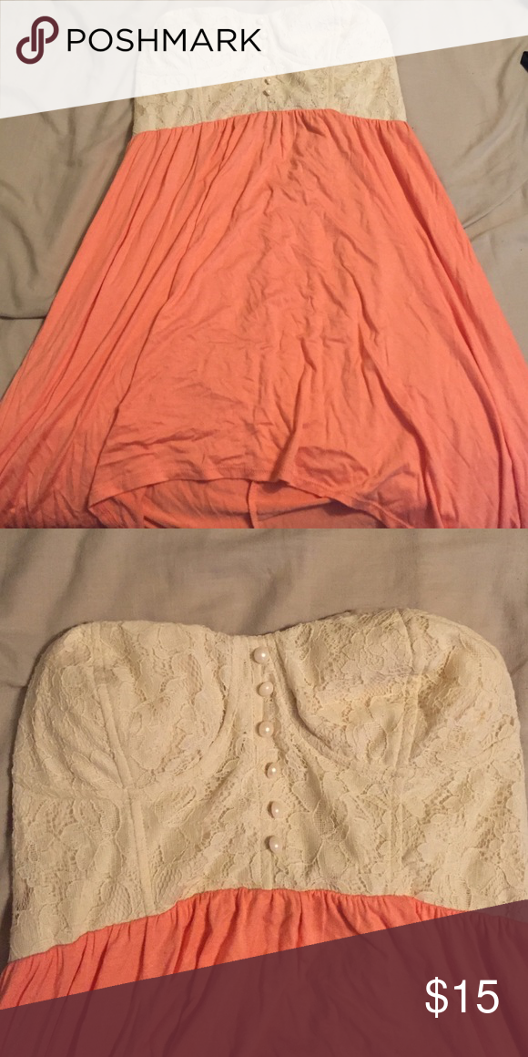Strapless Lace Dress: knee length XL Lacy bodice with pearl beads and peachy/pink skirt. Strapless with hoops for belt, but did not come with one. Would be cute with brown woven belt!   Never worn! Rue 21 Dresses Strapless