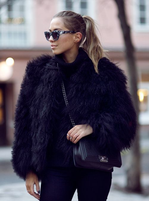 4293f3dc253d Kenza Zouiten is wearing a black fluffy faux fur jacket from Pello Bello