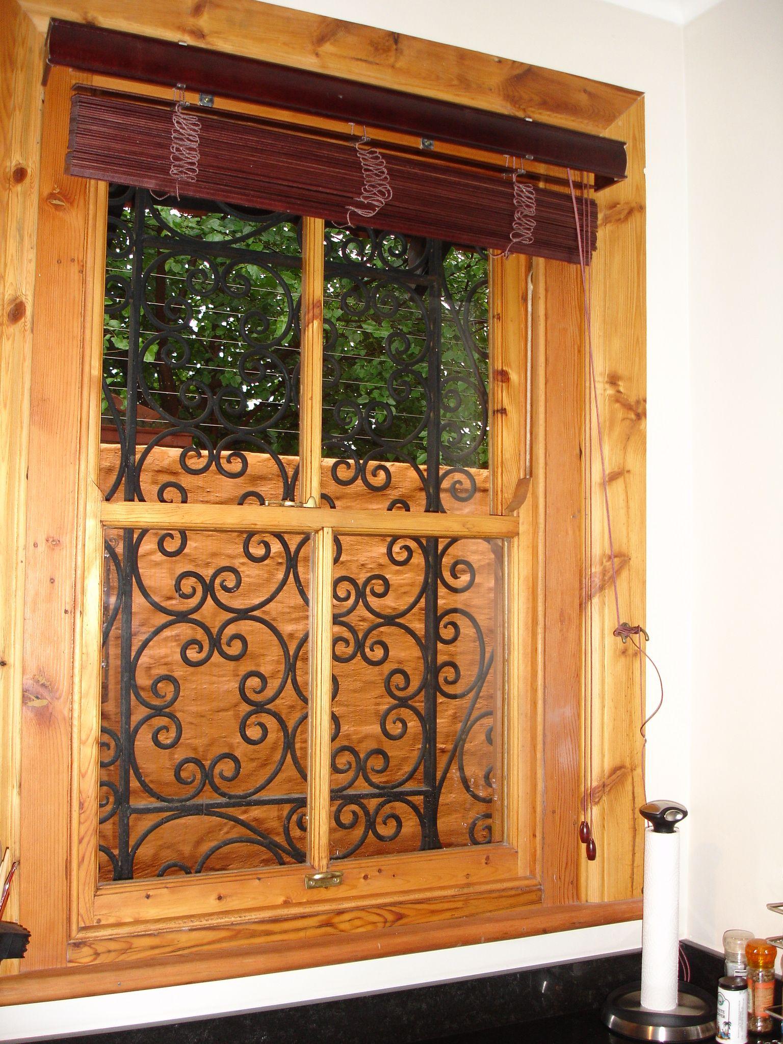 Sash Windows With Re Cycled Farm Gates As Burglar Bars