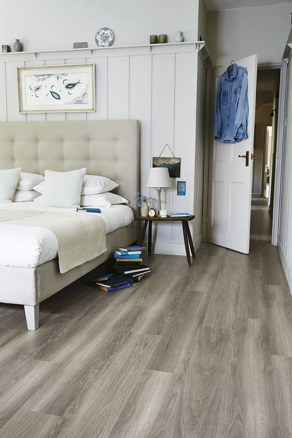 A light and bright modern bedroom with LVT wood effect ...