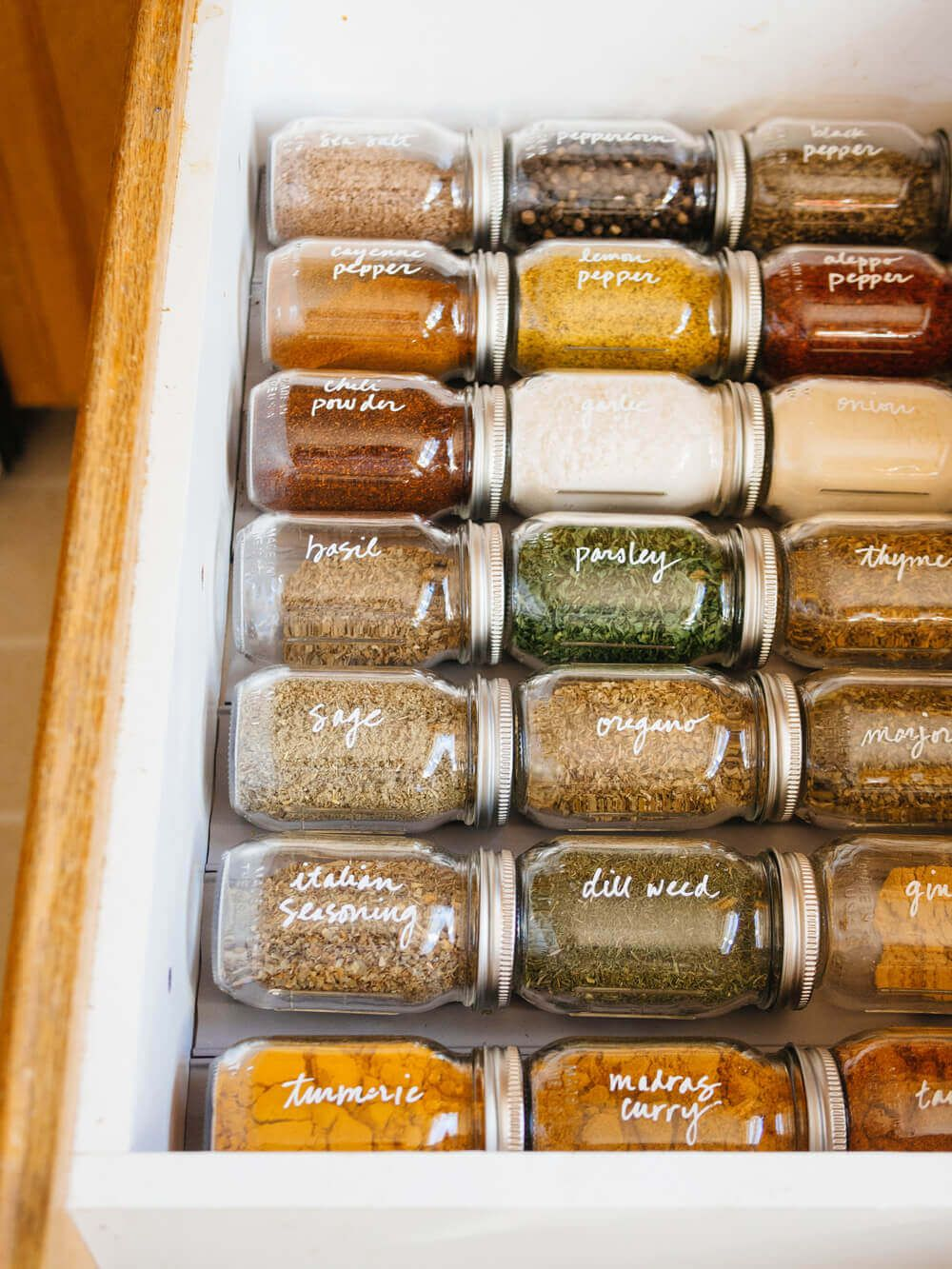 If you struggle to keep your spices organized and within easy reach, let my DIY spice drawer organization inspire you to take charge of that kitchen clutter. It's a simple, efficient, and attractive system for storing, labeling, and sorting 80-plus spice bottles, jars, tubs, and tins in kitchen drawers.