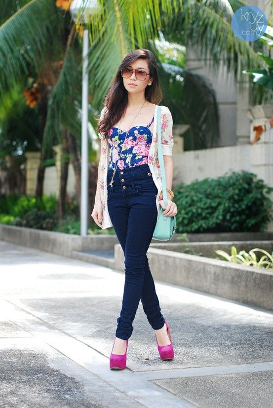 a corset top looks very cute and retro with dark high-waisted jeans