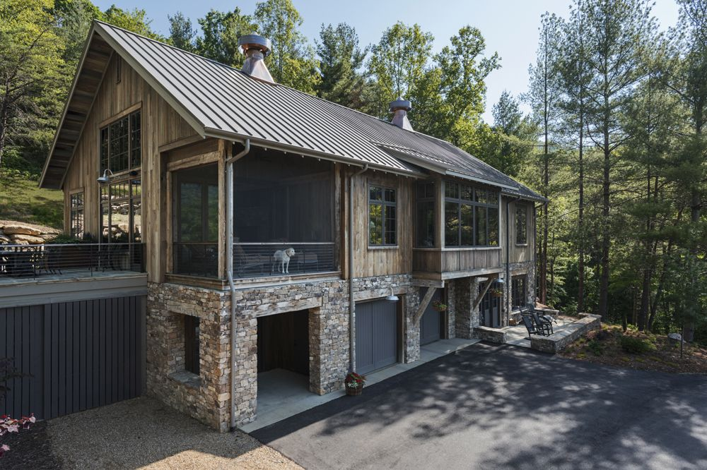 Modern Rustic Barn Home. Rustic reclaimed wood and stone are featured prominently in this reconstructed barn. Architecture by Samsel Architects from Asheville, NC.