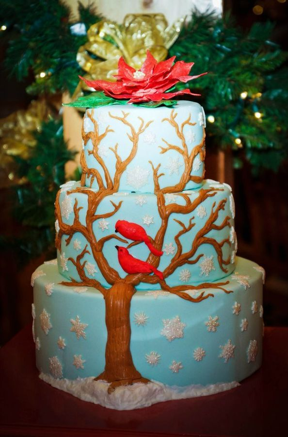 Winter Wedding.  250 snowflakes, fondant tree and cardinals, Poinsettia Sugar Flower.  Bottom tier Styrofoam.  The couple had this cake as well as individual cakes per table that you can see in my photos.