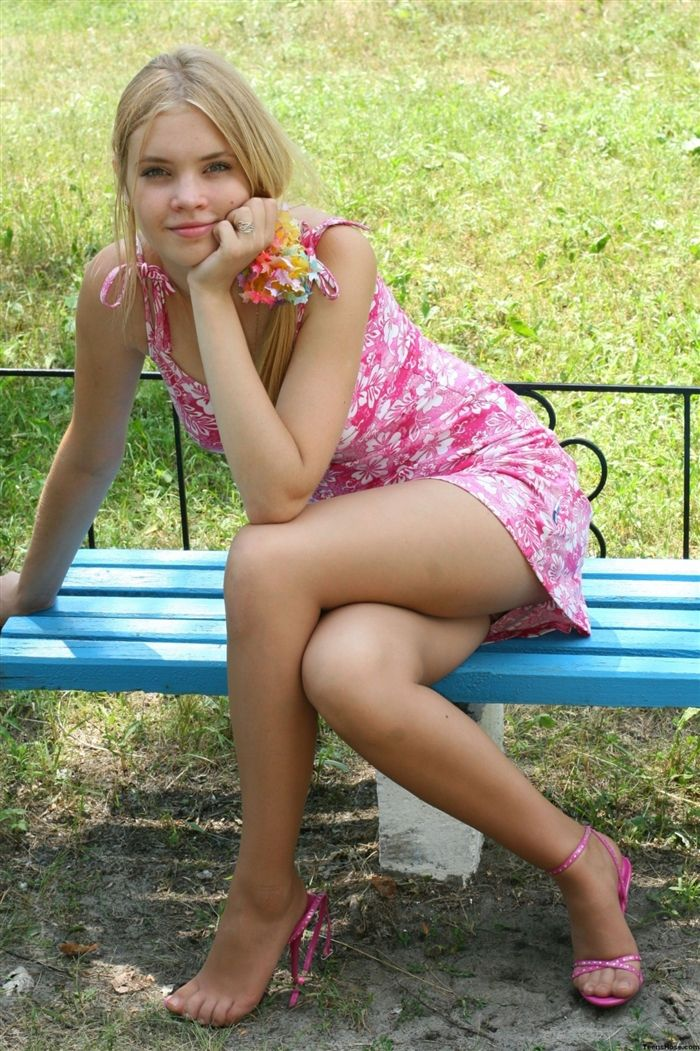 With Her Legs Crossed And One Shoe Off She Poses Showing ...
