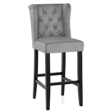 A Soft Grey Velvet Fabric Seat Complete With A Winged Backrest And