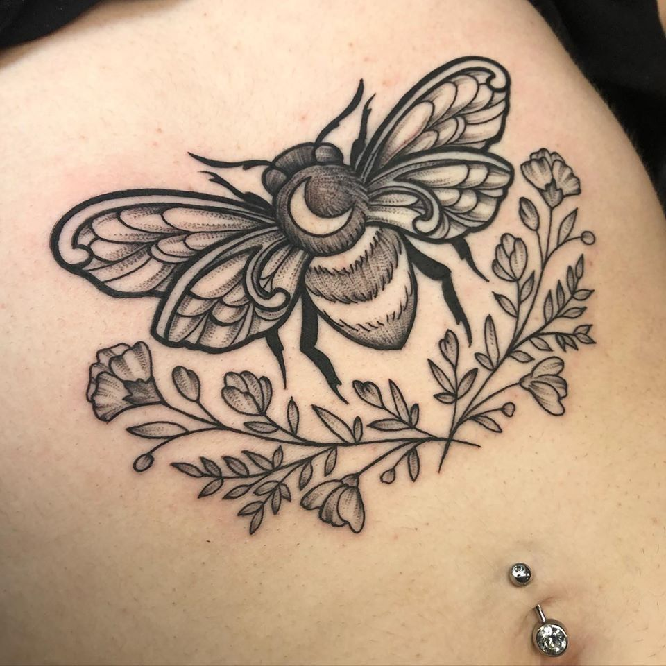 bee and floral torso tattoo